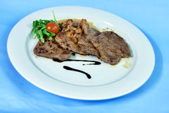 Grilled beef tenderloin with mushrooms and cream sauce Royalty Free Stock Images