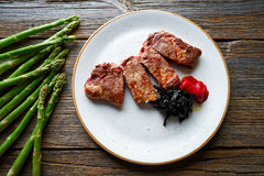 Grilled beef tenderloin with piquillo peppers Stock Photos