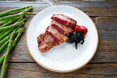 Grilled beef tenderloin with piquillo peppers Royalty Free Stock Photo