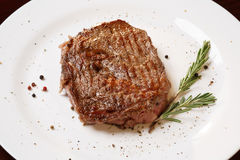 Grilled beef. Tenderloin on plate Stock Image