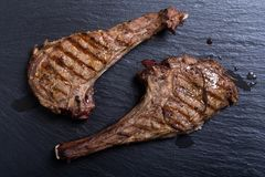 Grilled beef tomahawk steak. BBQ food background in plate royalty free stock image