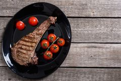 Grilled beef tomahawk steak. BBQ food background in plate stock images