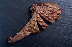 Grilled beef tomahawk steak. BBQ food background in plate stock photo