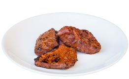 Grilled beef on a white plate Royalty Free Stock Photo