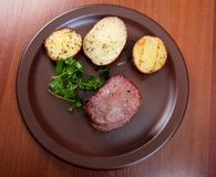 Grilled beef on white plate with potatoes Stock Photos