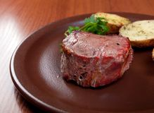 Grilled beef on white plate with potatoes Royalty Free Stock Image