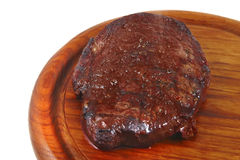 Grilled beef on wooden plate Royalty Free Stock Image