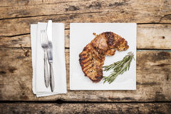 Grilled beefsteak decorated with rosemary bunch Royalty Free Stock Photography