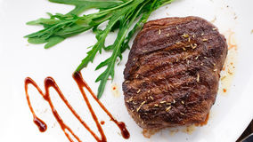 Grilled beefsteak on a plate Royalty Free Stock Photo