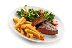 Grilled beefsteak with potatoes and vegetables. Grilled beefsteak with potatoes on white background stock image