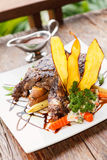 Grilled beefsteak on wooden table Stock Image