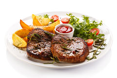 Grilled beefsteaks Stock Photos