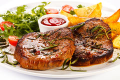 Grilled beefsteaks Royalty Free Stock Photo