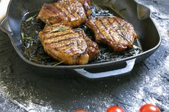 Grilled Black Angus Steak and meat fork on grill iron pan on wooden background stock images