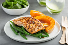 Grilled blackened salmon fillet with grilled squash. Grilled blackened salmon fillet with grilled butternut squash royalty free stock photography