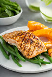 Grilled blackened salmon fillet with grilled squash Royalty Free Stock Image
