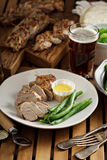 Grilled braided pork with green beans Royalty Free Stock Image