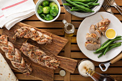 Grilled braided pork with green beans Stock Photos