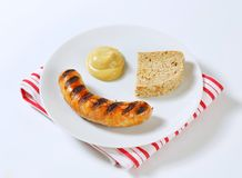 Grilled bratwurst with mustard Royalty Free Stock Photos