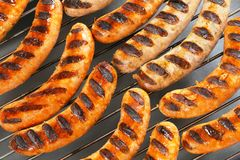 Grilled bratwursts Stock Photos