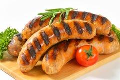 Grilled bratwursts Stock Photos