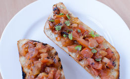 Grilled bread with tomatoes, garlic Royalty Free Stock Photos