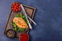 Grilled breas chicken with greenery. Copy space for text Royalty Free Stock Image
