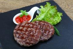 Grilled burger cutlet Stock Photos