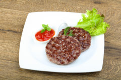 Grilled burger cutlet Royalty Free Stock Photos