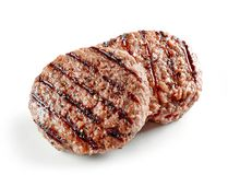 Grilled burger meat. Isolated on white background Royalty Free Stock Photo