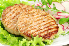Grilled burgers stock photography