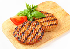 Grilled burgers Royalty Free Stock Photography