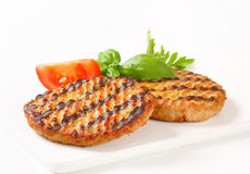 Grilled burgers Stock Images