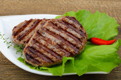 Grilled burget cutlet Royalty Free Stock Photos