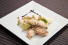 Grilled butterfish  w potato puree. Peas and lemon Stock Photos