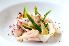 Grilled calamari with green asparagus. Royalty Free Stock Image