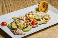 Grilled calamari with zucchini and almond flakes Stock Photos