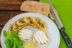 Grilled camembert with baguette Royalty Free Stock Image