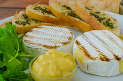 Grilled camembert with baguette Royalty Free Stock Photo