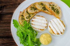 Grilled camembert with baguette Stock Photos