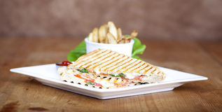 Grilled caprese sandwich with fried potatoes Stock Image