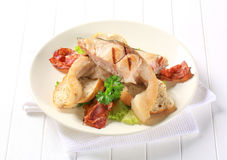 Grilled carp with bacon strips Stock Photography