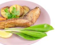 Grilled carp at dish Stock Photo