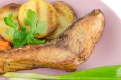 Grilled carp at dish Stock Image