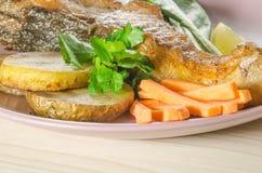 Grilled carp at dish Stock Photos