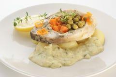 Grilled carp fillet on organic potato Stock Images