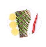 Grilled carp fillet on plate with onion and lemon. Royalty Free Stock Images