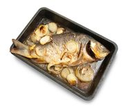 Grilled carp fish  on the cook griddle Royalty Free Stock Photography