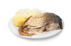 Grilled Carp fish with potatoes Stock Image