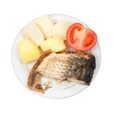 Grilled carp fish with potatoes and tomato Royalty Free Stock Photos